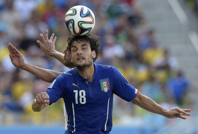 Italy midfielder Marco Parolo heads the ball during a Group D football match between Italy and Uruguay at the Dunas Arena in Natal during the 2014 FIFA World Cup on June 24, 2014. (DANIEL GARCIA/AFP/Getty Images)