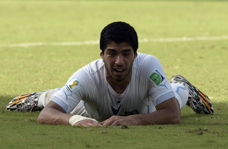 Uruguay forward Luis Suarez reacts on the pitch during a Group D football match between Italy and Uruguay at the Dunas Arena in Natal during the 2014 FIFA World Cup on June 24, 2014. (DANIEL GARCIA/AFP/Getty Images)