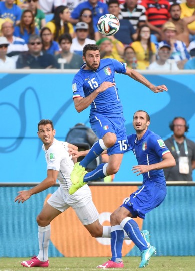 Italy defender Andrea Barzagli (center) heads the ball during the Group D football match between Italy and Uruguay at the Dunas Arena in Natal during the 2014 FIFA World Cup on June 24, 2014. (EMMANUEL DUNAND/AFP/Getty Images)