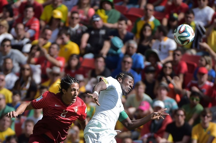 Portugal's defender Bruno Alves (L) and Ghana's forward and captain Asamoah Gyan vie during the Group G football match between Portugal and Ghana at the Mane Garrincha National Stadium in Brasilia during the 2014 FIFA World Cup on June 26, 2014. (Gabriel Boyus/AFP/Getty Images)