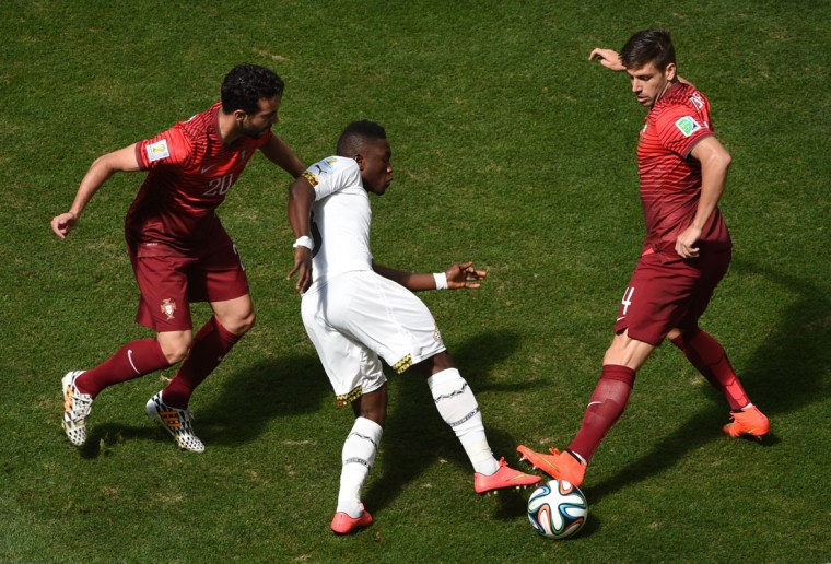 (From L-R) Portugal's midfielder Ruben Amorim, Ghana's forward Abdul Majeed Waris and Portugal's midfielder Miguel Veloso vie for the ball during the Group G football match between Portugal and Ghana at the Mane Garrincha National Stadium in Brasilia during the 2014 FIFA World Cup on June 26, 2014. (Evaristo Sa/AFP/Getty Images)