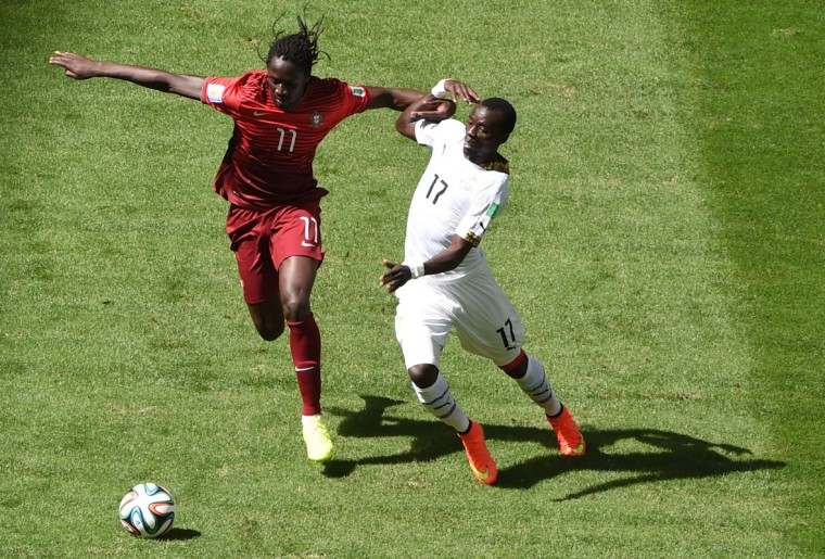 Portugal's forward Eder (L) and Ghana's midfielder Mohammed Rabiu vie for the ball during the Group G football match between Portugal and Ghana at the Mane Garrincha National Stadium in Brasilia during the 2014 FIFA World Cup on June 26, 2014. (Evaristo Sa/AFP/Getty Images)