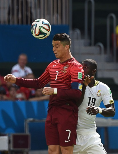 Portugal's forward and captain Cristiano Ronaldo (L) and Ghana's defender Jonathan Mensah vie for the ball during the Group G football match between Portugal and Ghana at the Mane Garrincha National Stadium in Brasilia during the 2014 FIFA World Cup on June 26, 2014. (Christophe Simon/AFP/Getty Images)