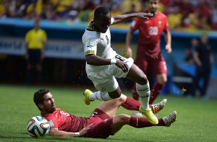 Portugal's midfielder Joao Moutinho (L) and Ghana's midfielder Emmanuel Agyemang Badu vie during the Group G football match between Portugal and Ghana at the Mane Garrincha National Stadium in Brasilia during the 2014 FIFA World Cup on June 26, 2014. (Gabriel Bouys/AFP/Getty Images)