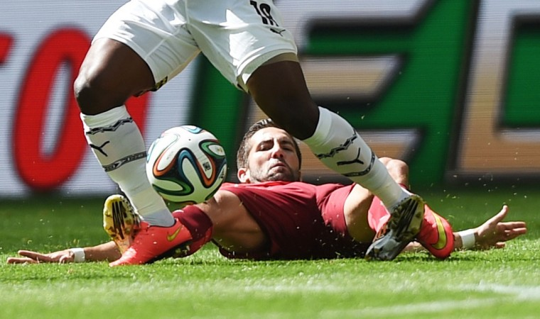 Ghana's forward Abdul Majeed Waris (top) and Portugal's midfielder Joao Moutinho vie during the Group G football match between Portugal and Ghana at the Mane Garrincha National Stadium in Brasilia during the 2014 FIFA World Cup on June 26, 2014. (Francisco Leong/AFP/Getty Images)
