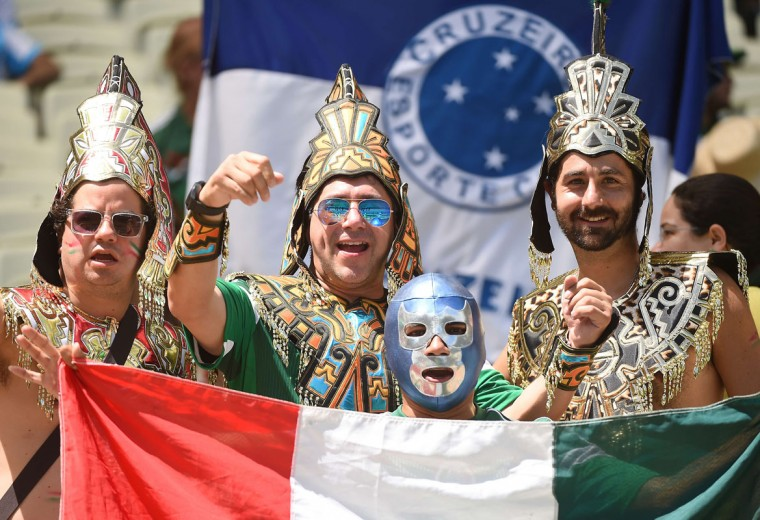 Mexican supporters cheer for their team ahead of the Round of 16 football match between Netherlands and Mexico at Castelao Stadium in Fortaleza during the 2014 FIFA World Cup on June 29, 2014. (Emmanuel Dunand/AFP/Getty Images)