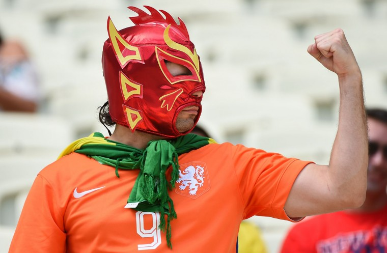 A Netherlands supporter cheers for his team ahead of the Round of 16 football match between Netherlands and Mexico at Castelao Stadium in Fortaleza during the 2014 FIFA World Cup on June 29, 2014. (Emmanuel Dunand/AFP/Getty Images)