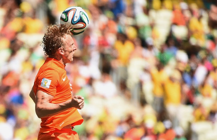 Netherlands' forward Dirk Kuyt heads the ball during a Round of 16 football match between Netherlands and Mexico at Castelao Stadium in Fortaleza during the 2014 FIFA World Cup on June 29, 2014. (Emmanuel Dunand/AFP/Getty Images)