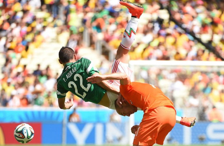Netherlands' forward Arjen Robben (R) is challenged by Mexico's defender Paul Aguilar during a Round of 16 football match between Netherlands and Mexico at Castelao Stadium in Fortaleza during the 2014 FIFA World Cup on June 29, 2014. (Emmanuel Dunand/AFP/Getty Images)