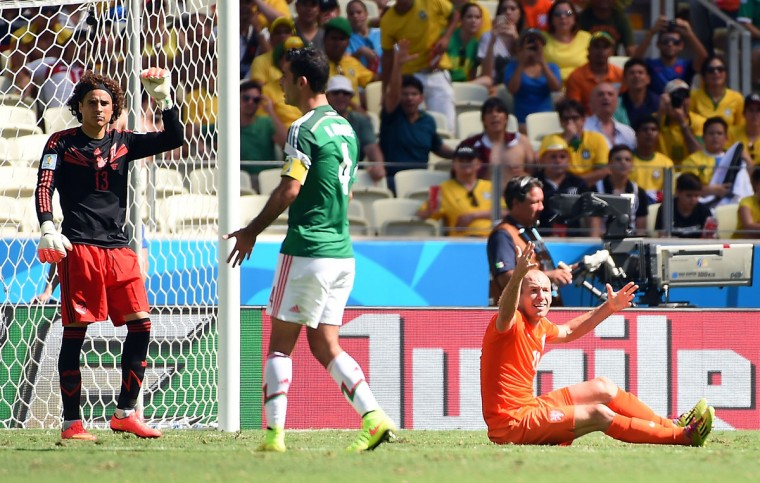 Netherlands' forward Arjen Robben (R) reacts after a challenge as Mexico's goalkeeper Guillermo Ochoa (L) and Mexico's defender and captain Rafael Marquez (C) look on during a Round of 16 football match between Netherlands and Mexico at Castelao Stadium in Fortaleza during the 2014 FIFA World Cup on June 29, 2014. (Emmanuel Dunand/AFP/Getty Images)