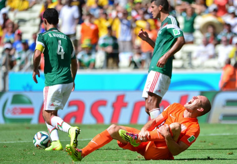 Netherlands' forward Arjen Robben (R) reacts to a tackle during a Round of 16 football match between Netherlands and Mexico at Castelao Stadium in Fortaleza during the 2014 FIFA World Cup on June 29, 2014. (Yuri Cortez/AFP/Getty Images)