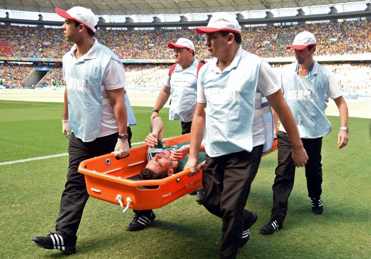 Mexico's defender Hector Moreno is stretched out during a Round of 16 football match between Netherlands and Mexico at Castelao Stadium in Fortaleza during the 2014 FIFA World Cup on June 29, 2014. (Yuri Cortez/AFP/Getty Images)
