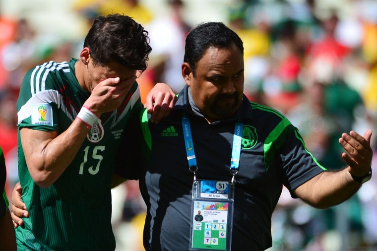 Mexico's defender Hector Moreno (L) reacts to a tackle during a Round of 16 football match between Netherlands and Mexico at Castelao Stadium in Fortaleza during the 2014 FIFA World Cup on June 29, 2014. (Yuri Cortez/AFP/Getty Images)