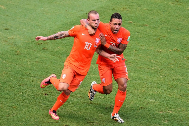 Netherlands' midfielder Wesley Sneijder (L) celebrates with teammate Netherlands' forward Memphis Depay after scoring during a Round of 16 football match between Netherlands and Mexico at Castelao Stadium in Fortaleza during the 2014 FIFA World Cup on June 29, 2014. (Javier Soriano/AFP/Getty Images)