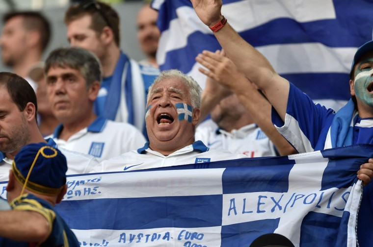 Greek fans cheer prior to a Round of 16 football match between Costa Rica and Greece at Pernambuco Arena in Recife during the 2014 FIFA World Cup on June 29, 2014. (Aris Messinis/AFP/Getty Images)