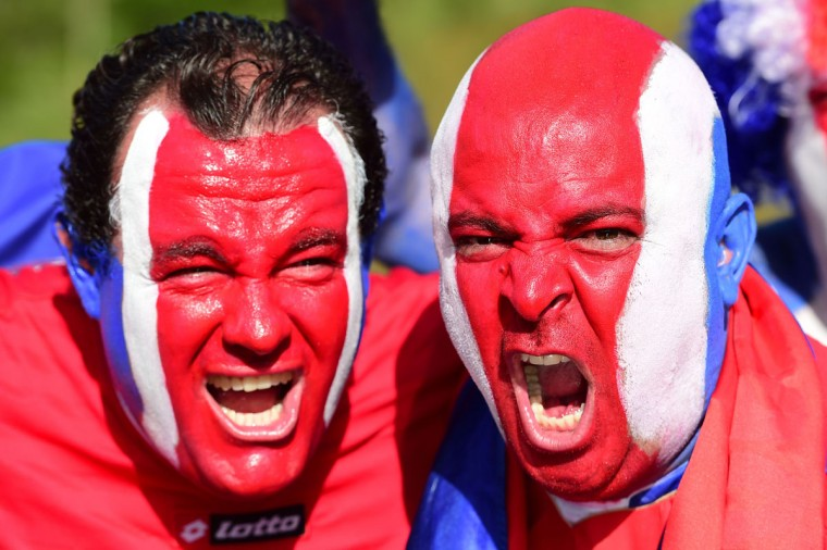 Costa Rica's fans cheer for their team as they arrive to attend the round of 16 football match between Costa Rica and Greece at Pernambuco Arena in Recife during the 2014 FIFA World Cup on June 29, 2014. (Ron Schemidt/AFP/Getty Images)