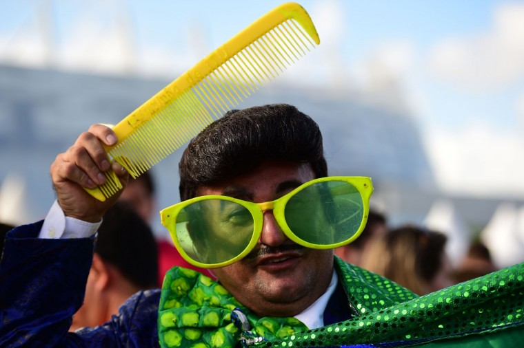 A fan arrives to attend the round of 16 football match between Costa Rica and Greece at Pernambuco Arena in Recife during the 2014 FIFA World Cup on June 29, 2014. (Ron Schemidt/AFP/Getty Images)