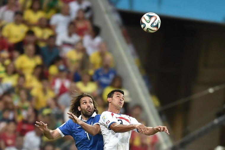 Greece's forward Georgios Samaras (L) vies with Costa Rica's defender Giancarlo Gonzalez during a Round of 16 football match between Costa Rica and Greece at Pernambuco Arena in Recife during the 2014 FIFA World Cup on June 29, 2014. (Aris Messinis/AFP/Getty Images)