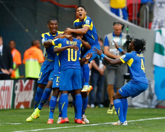 Enner Valencia of Ecuador (hidden) celebrates scoring his team's first goal with his teammates during the 2014 FIFA World Cup Brazil Group E match between Switzerland and Ecuador at Estadio Nacional on June 15, 2014 in Brasilia, Brazil. (Matthew Lewis/Getty Images)