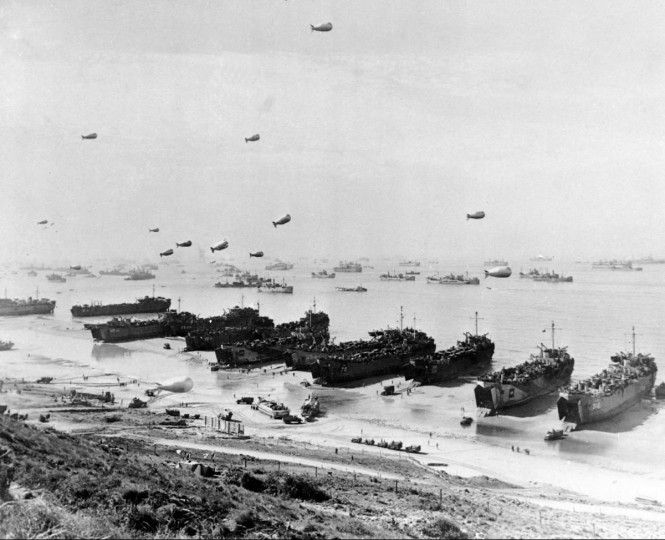 This was the scene along a section of Omaha Beach in June 1944 during Operation Overlord, the code name for the Normandy invasion during World War II. Large-landing craft put troops and supplies on shore at Omaha, one of five invasion beaches. In background is part of the fleet of 2,727 ships that brought the allied troops from Britain. In the air are barrage balloons, designed to entangle low-flying attack aircraft in their cables. (AP file photo)