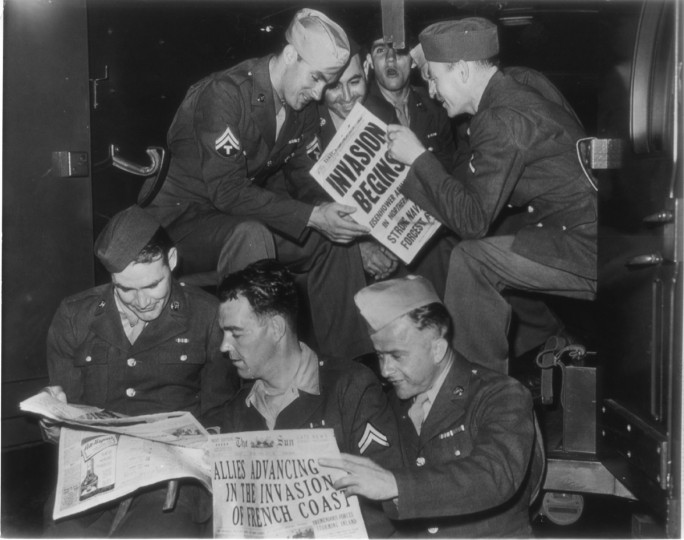 The invasion was good news to this group of U.S. soldiers in Jersey City N. J., part of a contingent of 51 American doughboys who were prisoners of war in Germany, as they arrived after an exchange on the Swedish liner Grips-Holm. (Baltimore Sun file photo)