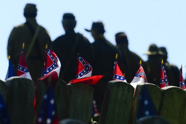 An honor guard stands at ease during the 141st commemoration of Confederate Memorial Day in Maryland. (Doug Kapustin/for The Baltimore Sun)