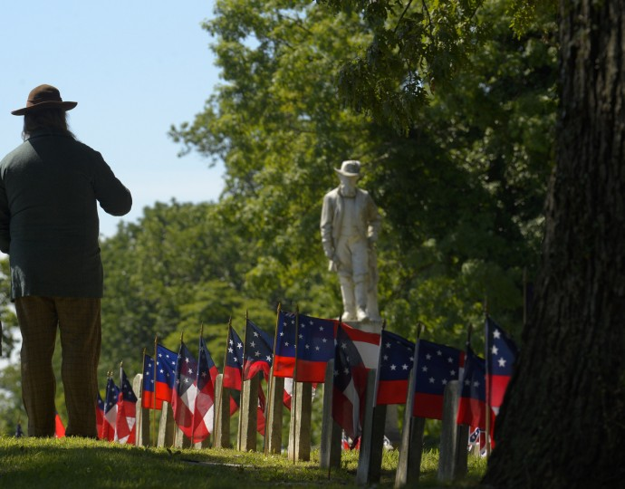 "As the ""Stonewall"" Jackson monument looms over the graves, many gather at Loudon Park Cemetery to attend the 141st commemoration of Confederate Memorial Day in Maryland. (Doug Kapustin/for The Baltimore Sun)"