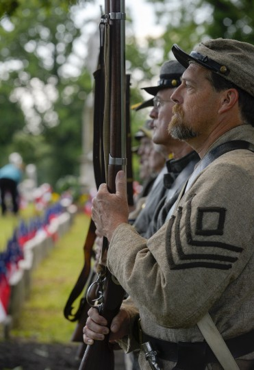 Representing the 2nd Virginia Infantry, Tim Myers of Bel Air, stands at attention with the honor guard. (Doug Kapustin/for The Baltimore Sun)