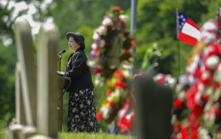 Lucy Slaich, from the Harford County chapter of the United Daughters of the Confederacy speaks as many gather at Loudon Park Cemetery. (Doug Kapustin/for The Baltimore Sun)