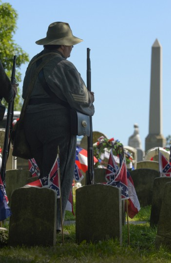 Part of an honor guard stands at attention while many gather at Loudon Park Cemetery to attend the 141st commemoration of Confederate Memorial Day in Maryland. (Doug Kapustin/for The Baltimore Sun)