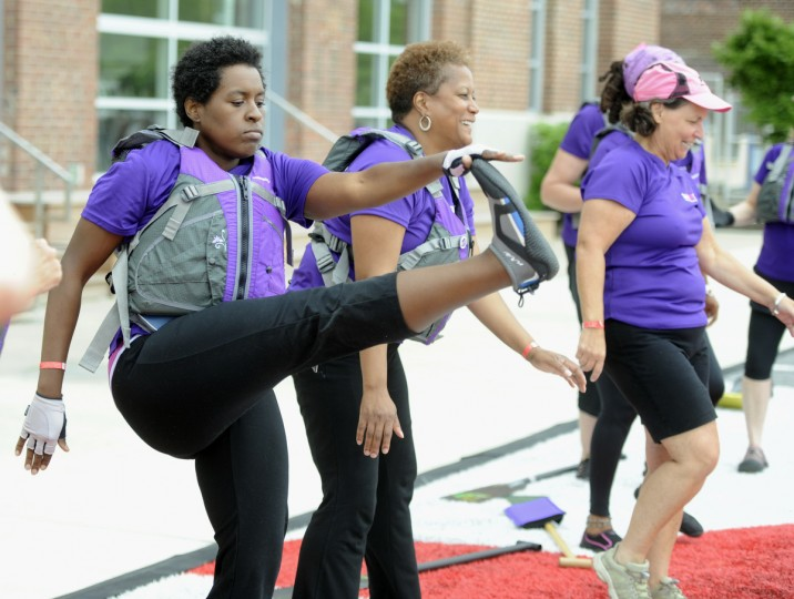 Valerie Ballard, Capital Heights, stretches. She is a member of Go Pink DC, a dragon boat team of breast cancer survivors and supporters. (Kim Hairston/Baltimore Sun)