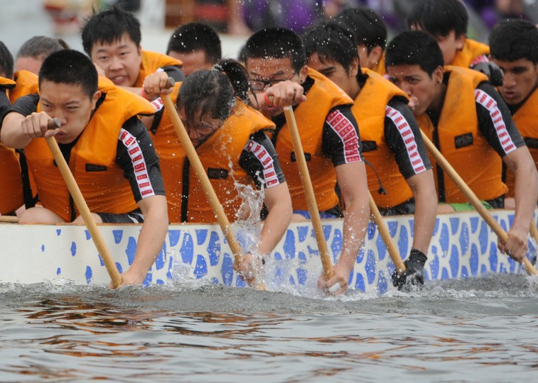 The DCH Dragon Boat Racing junior team competes in a 500 meter time trial in the 2014 Baltimore Dragon Boat Challenge hosted by The Baltimore Dragon Boat Club. (Kim Hairston/Baltimore Sun)