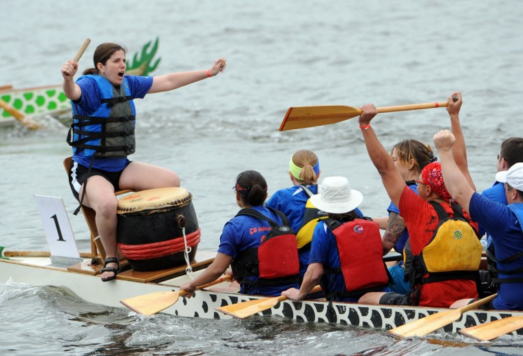 Maralee Csellar, of Arlington, raises her arms before leading the Honey Badgers, a southeast D.C. Coast Guard dragon boat team, in a team cheer. (Kim Hairston/Baltimore Sun)