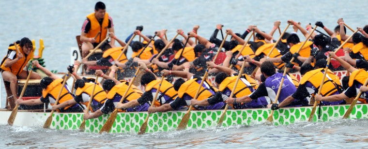 Team Kaya (foreground) competes against DCH Dragon Boat Racing 2 in 500 meter time trial in the 2014 Baltimore Dragon Boat Challenge hosted by The Baltimore Dragon Boat Club. Team Kaya is raising money for Alex's Lemonade Stand Foundation, to find a cure for childhood cancer. (Kim Hairston/Baltimore Sun)