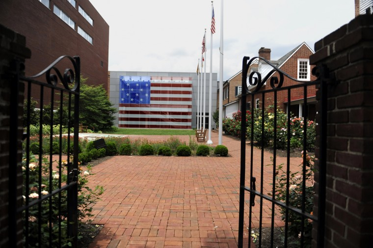This is a view of the front gate at the Star Spangled Banner Museum and Flag House as seen from the garden gates. (Barbara Haddock Taylor/Baltimore Sun)