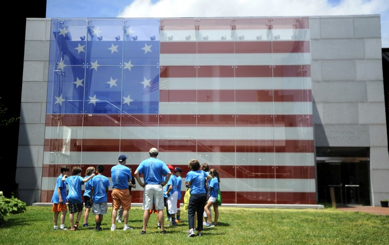 Visitors from Lambertsville Public School in Lambertsville NJ stand outside the Flag House and Star-Spangled Banner Museum. (Barbara Haddock Taylor/Baltimore Sun)