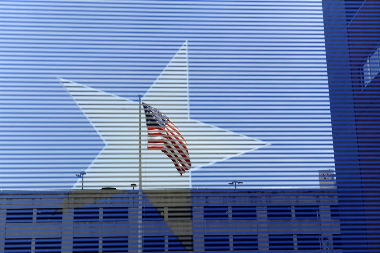 A replica of the flag that flew over Fort McHenry and inspired the national anthem is seen through a star on one of the windows at the Flag House and Star-Spangled Banner Museum. (Barbara Haddock Taylor/Baltimore Sun)