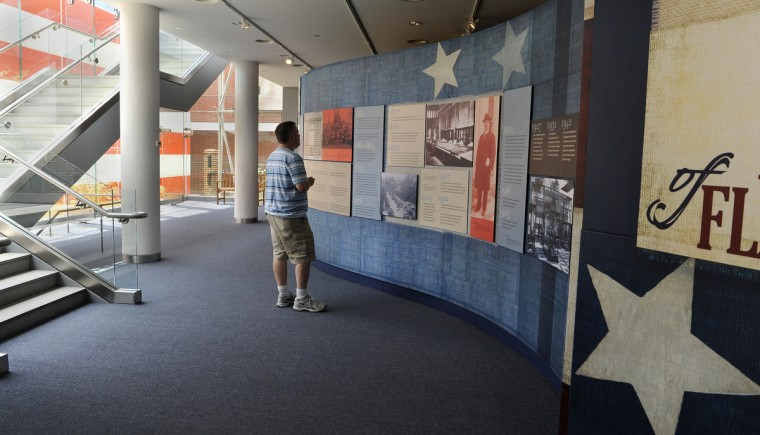 Mike Watts, who is visiting from Electra TX, looks at a display at the Flag House and Star-Spangled Banner Museum, where Mary Pickersgill sewed the flag that flew over Fort McHenry and inspired the national anthem. (Barbara Haddock Taylor/Baltimore Sun)