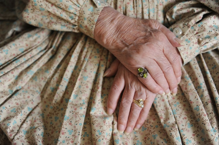 These are the hands of Jeannie Walden, who is 81 and has been portraying a woman of the Civil War era for Memorial Day and other patriotic observances for the last 25 years. She is sitting down taking a break before leaving for the Memorial Day Observance at Dulaney Valley Gardens. (Barbara Haddock Taylor/Baltimore Sun)