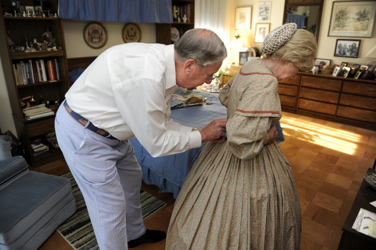 Alan Walden, left, helps his wife of 35 years, Jeannie Walden, get into her replica of an 1860s era hoop dress. (Barbara Haddock Taylor/Baltimore Sun)