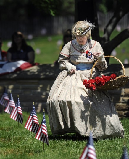 """Jeannie Walden, 81, portrays a Civil War widow for the 25th time at the annual Memorial Day Observance at Dulaney Valley Memorial Gardens. She placed flowers on graves of soldiers in the """"Circle Of Immortals."""" (Barbara Haddock Taylor/Baltimore Sun)"""