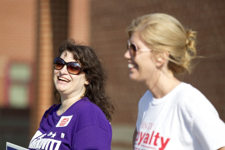Candidates for County Council District 1 Lisa Markovitz, left, and Wendy Royalty wait for voters at Hollifield Station Elementary on Tuesday, June 24, 2014. (Jen Rynda/BSMG)