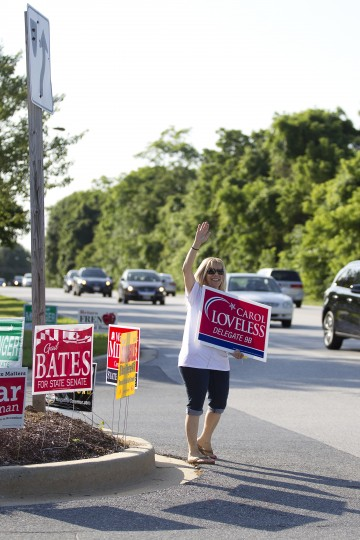 Jen Nussbaum of Ellicott City campaigns for her friend Carol Loveless on Rogers Avenue near Hollifield Station Elementary. (Jen Rynda/BSMG)