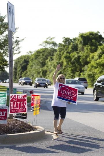 Jen Nussbaum of Ellicott City campaigns for her friend Carol Loveless on Rogers Avenue near Hollifield Station Elementary. (Jen Rynda/BSMG)