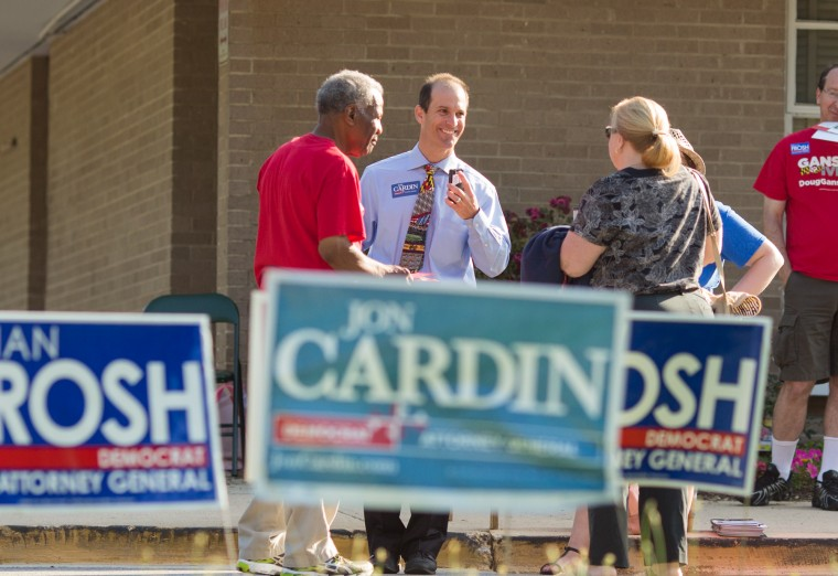 Jon Cardin, candidate for Attorney General, center in blue, campaigns to voters making their way into Bond Mill Elementary School. (Nate Pesce/BSMG)