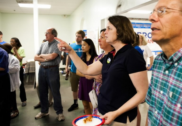Courtney Watson, a Democratic candidate for Howard County executive, watches primary election results come in at the Brown/Ulman headquarters in Columbia. (Noah Scialom/BSMG)