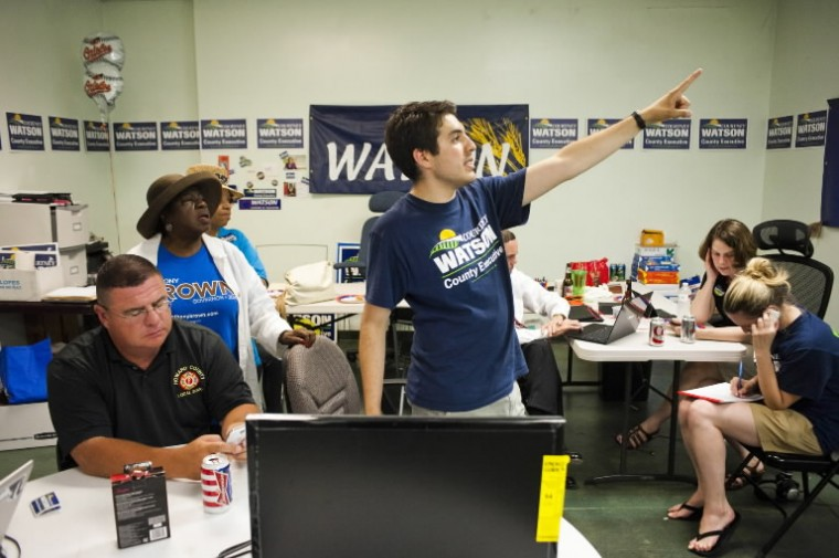 Dylan Goldberg, field director for Courtney Watson's campaign for Howard County Executive, points in excitement as primary election numbers come in at the Brown/Ulman headquarters in Columbia. (Noah Scialom/BSMG)
