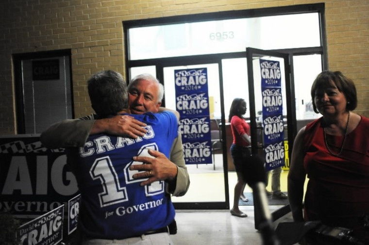 David Craig is embraced by one of his supporters after conceding the Republican nomination for governor to Larry Hogan at his campaign headquarters in Rosedale on Tuesday, June 24. (Brian Krista/BSMG)