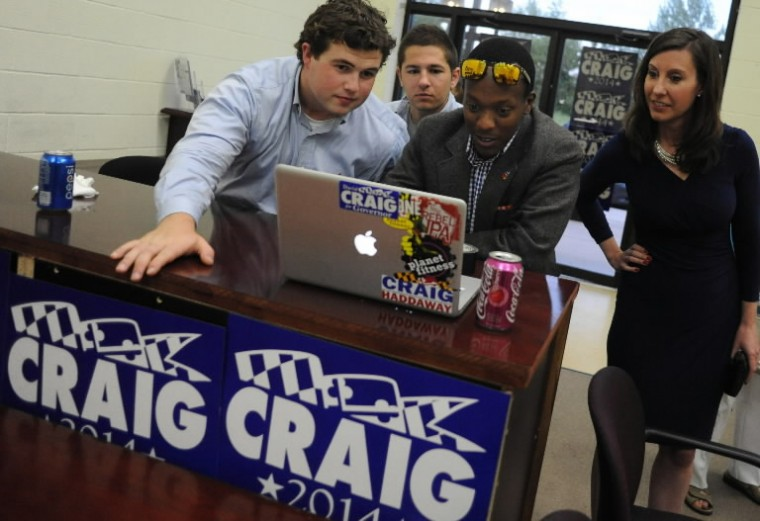 Jeannie Haddaway, right, David Craig's running mate, checks out early election results posted online with campaign workers, from left, Andrew Nehring, Tony Orbino and Eric Maranga at the campaign headquarters in Rosedale on Tuesday, June 24. (Brian Krista/BSMG)