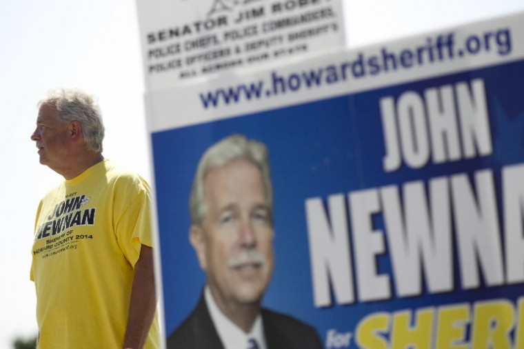 Candidate John Newnan spends some time outside of Long Reach High School during the primary election in Columbia. (Jen Rynda/BSMG)